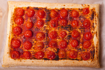 baked puff pastry with tomatos