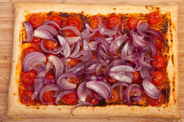 baked puff pastry with tomatos and onions
