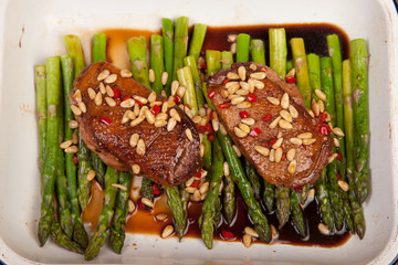 duck breast with pine nuts and asparagus