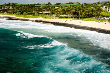Waves running up the seashore in Kauai, HI