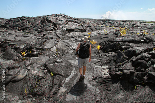 Man Hiking on Cooled Lava - 70874086