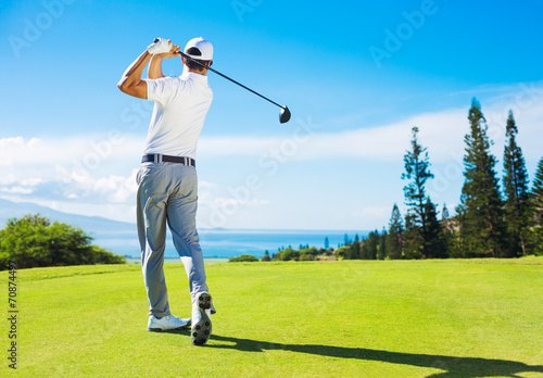 Man Playing Golf, Hitting Ball from the Tee - 70874497