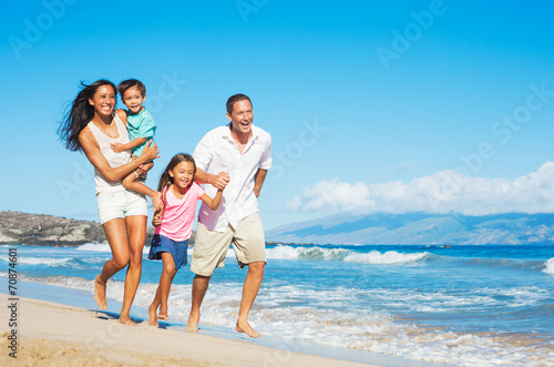 Happy Family on the Beach - 70874601