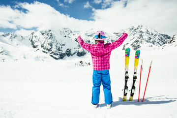 Ski, winter fun -  skier girl enjoying ski vacation