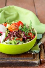fresh salad with arugula, radish and tomatoes