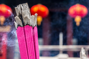 Closeup shot of joss stick in a Chinese temple