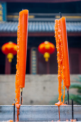 Closeup shot of twin candles in Chinese temple