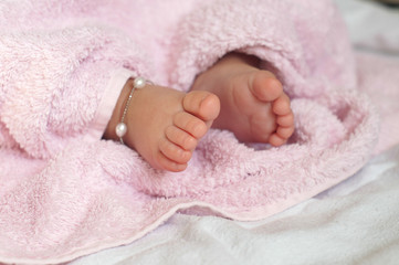 Close-up of  Baby feet under blanket