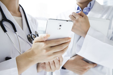 Doctor looking at the mobile phone