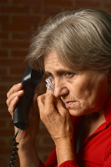 Sick aged woman calling doctor
