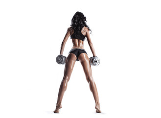 sexy muscled fitness brunette girl posing with dumbbells © Fotokvadrat