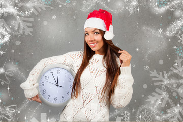 Beautiful woman holding the clock.  5 minutes to twelve