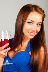 beautiful young woman with glass of red wine