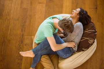 Cute couple laughing together on beanbag