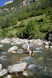 Back view of fly fisherman fishing in river