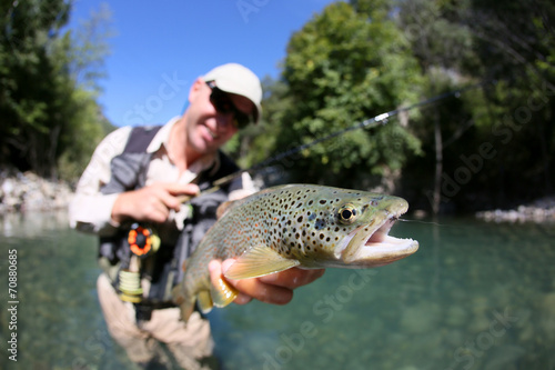 Fotobehang Vissen Fly fisherman holding fario trout recently caught