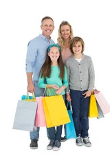 Portrait of smiling family with shopping bag