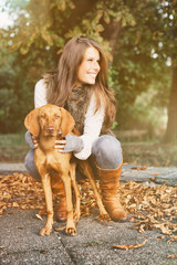 Attractive girl in october with dog 1