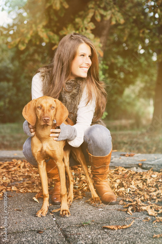 canvas print picture Attractive girl in october with dog 1