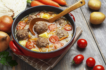 Cabbage soup with meatballs and tomatoes