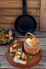Fried cepes with bacon, garlic and rosemary