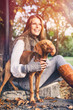 Attractive girl in october with dog