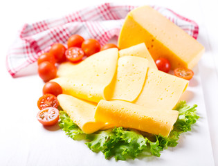slices of cheese with tomatoes