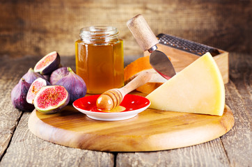 parmesan cheese with fresh figs and honey