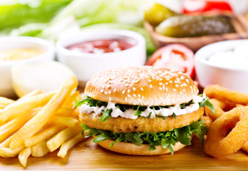 burger with chicken and fries