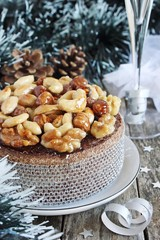 Christmas cake with caramelized nuts,chocolate and spices.