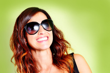 Beautiful smiling woman with sunglasses