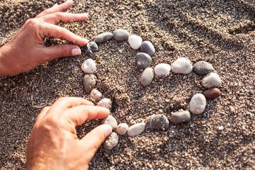 Heart symbol is made of marine shingles.