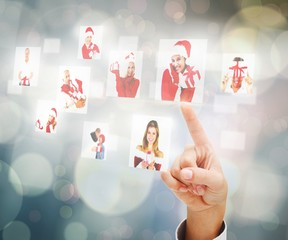 Composite image of hand pointing to christmas people collage