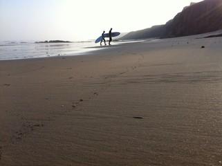 surfer silhouette beach
