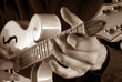 playing mandolin,sepia image