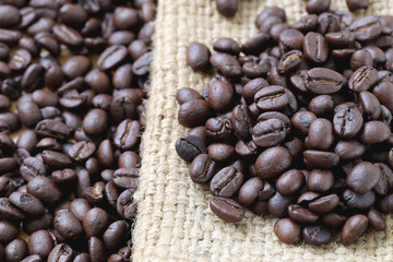 Coffee beans placed on bag sack.