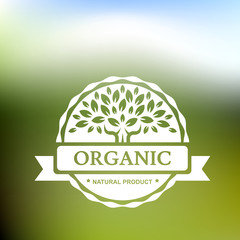 Organic product badge with tree on blurred landscape. Vector ill