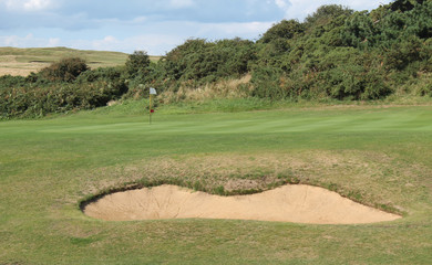 A Green and Bunker on a Links Golf Course.