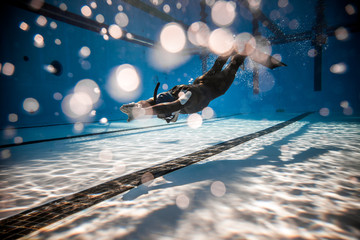 Freediver Performing during a DYN Freediving Competition