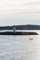 Fishing Boat Past Lighthouse in Dawn Light
