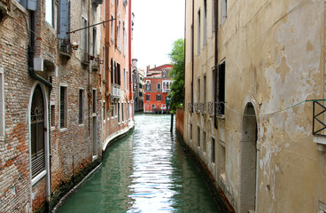 narrow navigable canal in Venice in Italy