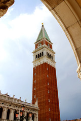 Bell tower of Saint Mark with the Arch of the Ducal Palace