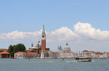 Bell tower of Saint George in the venetian lagoon and the boat