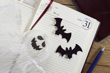 Halloween calendar with ghost and bats