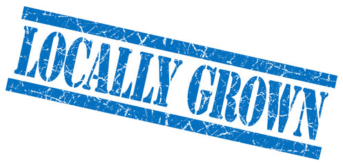 locally grown blue grungy stamp on white background