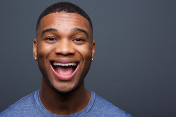 Young black man with funny smiling expression
