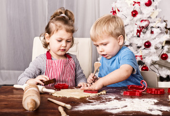 child baking christmas cookies