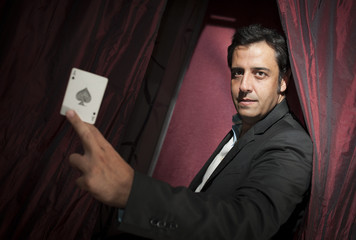 Magician with ace card