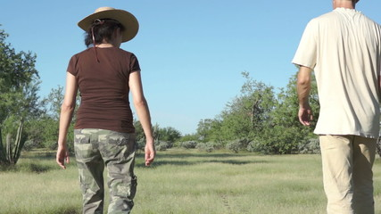 Couple Walking Outdoors in Arid Grasslands