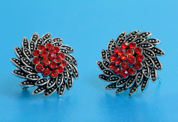 silver jewelry with red stones inside